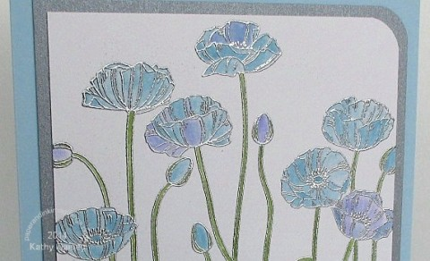 silver embossed poppies close up